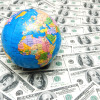 Globe over many american dollar bank notes