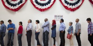 Voters waiting to vote in polling place