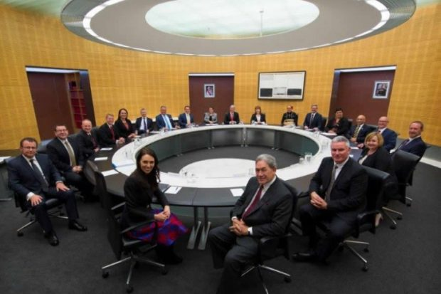 Labour and New Zealand First Ministers under the first term of the sixth Labour government sitting in the Cabinet office.